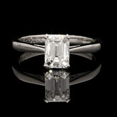 AN EMERALD CUT DIAMOND AND PLATINUM SOLITAIRE RING BY HANCOCKS