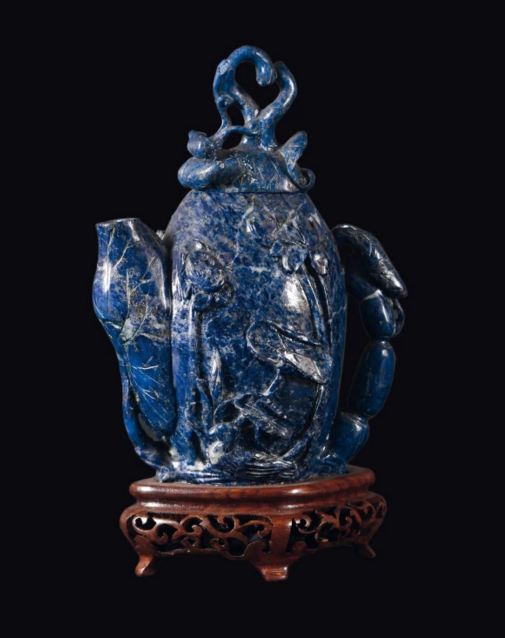 China Tiny teapot in lapis carved with fruit motifs