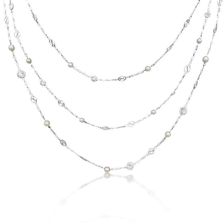 A DIAMOND, CULTURED PEARL AND PLATINUM NECKLACE, CIRCA 1910
