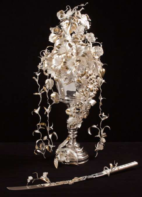 Artistic cup composition made of silver.