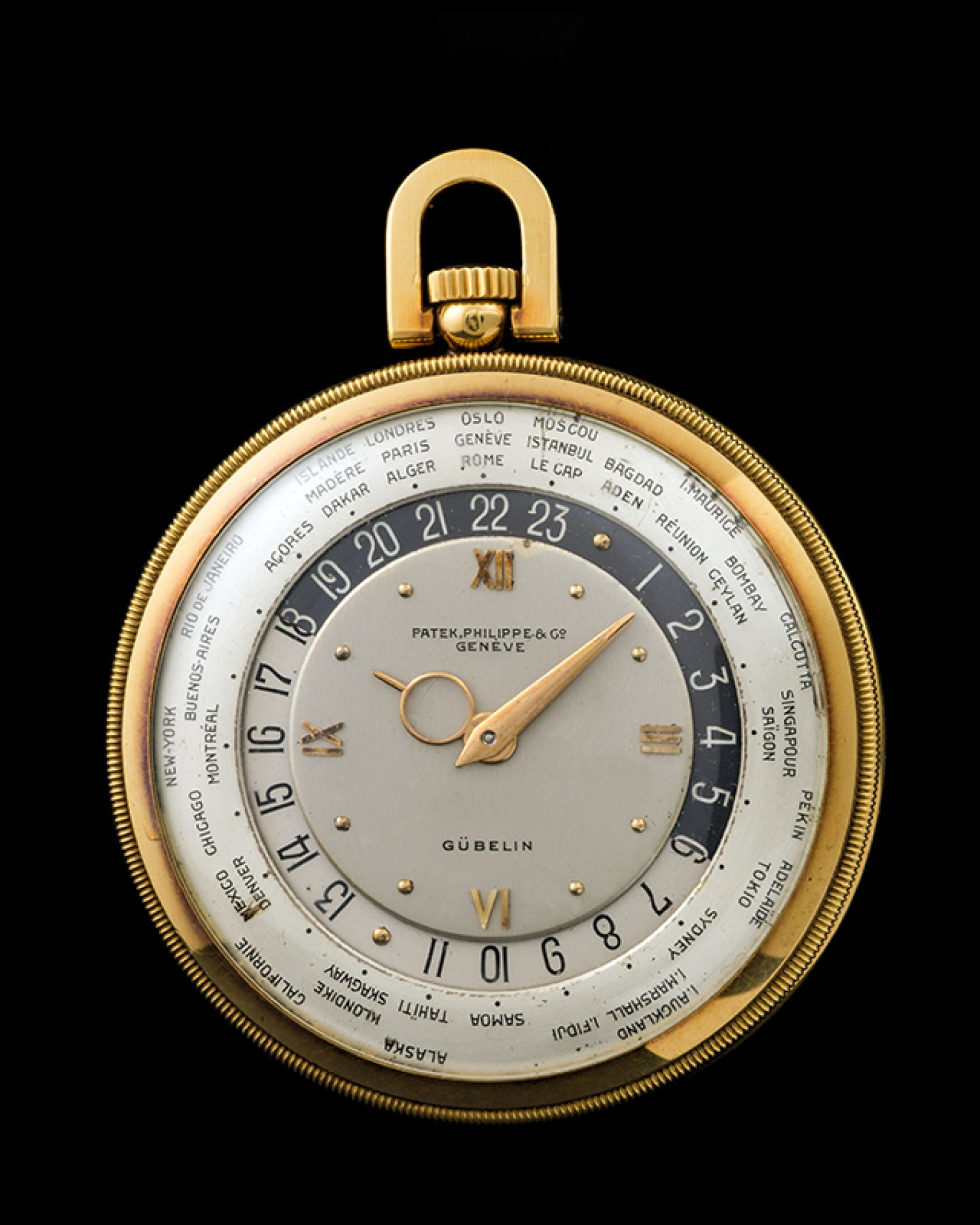 """Patek Philippe """"The yellow gold Worldtime pocketwatch retailed by Gübelin"""""""