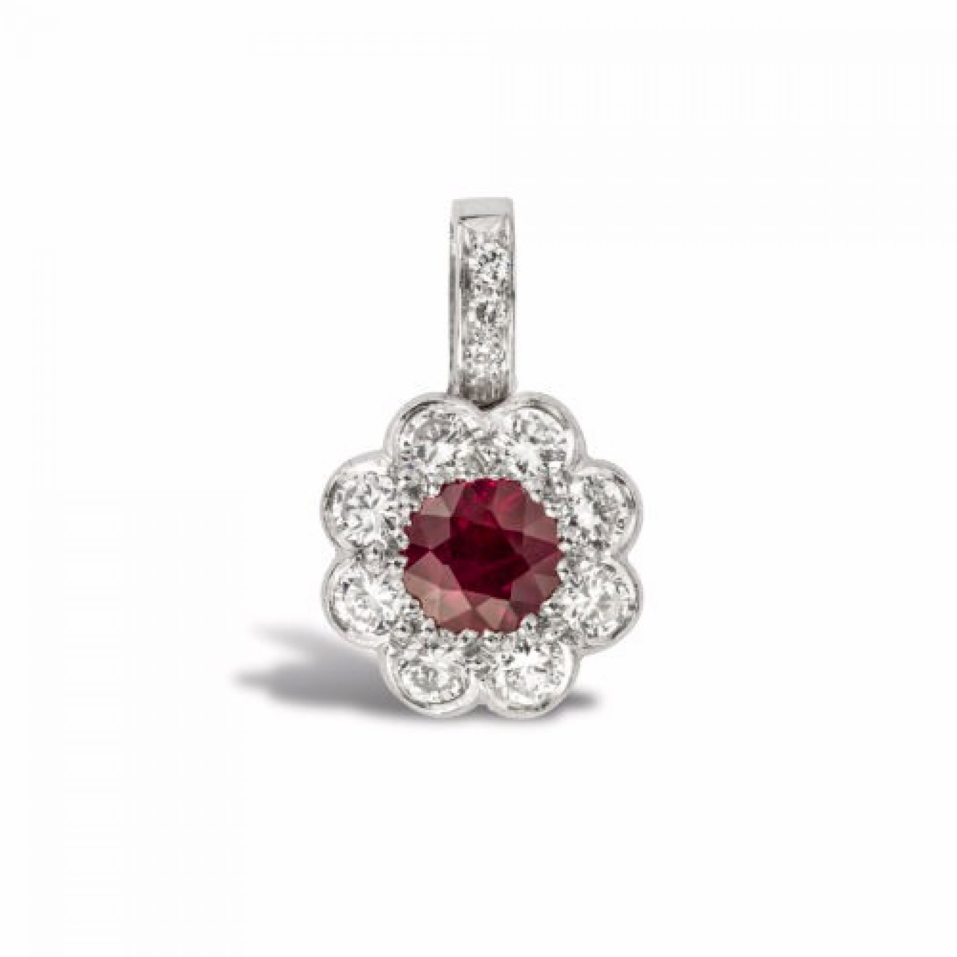 A ruby and diamond cluster pendant