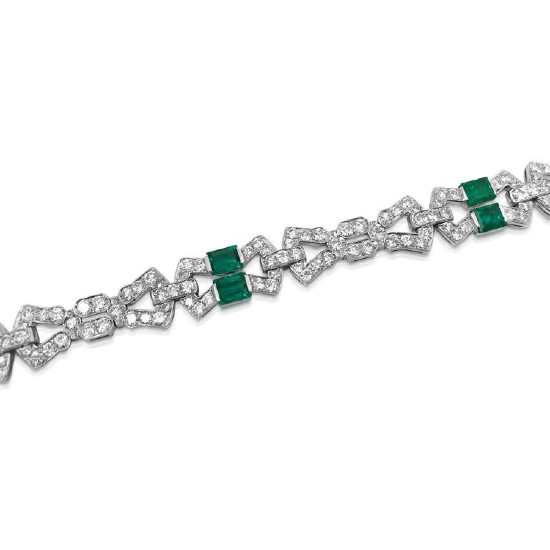 AN ART DECO EMERALD AND DIAMOND BRACELET, BY CHARLES HOLL.