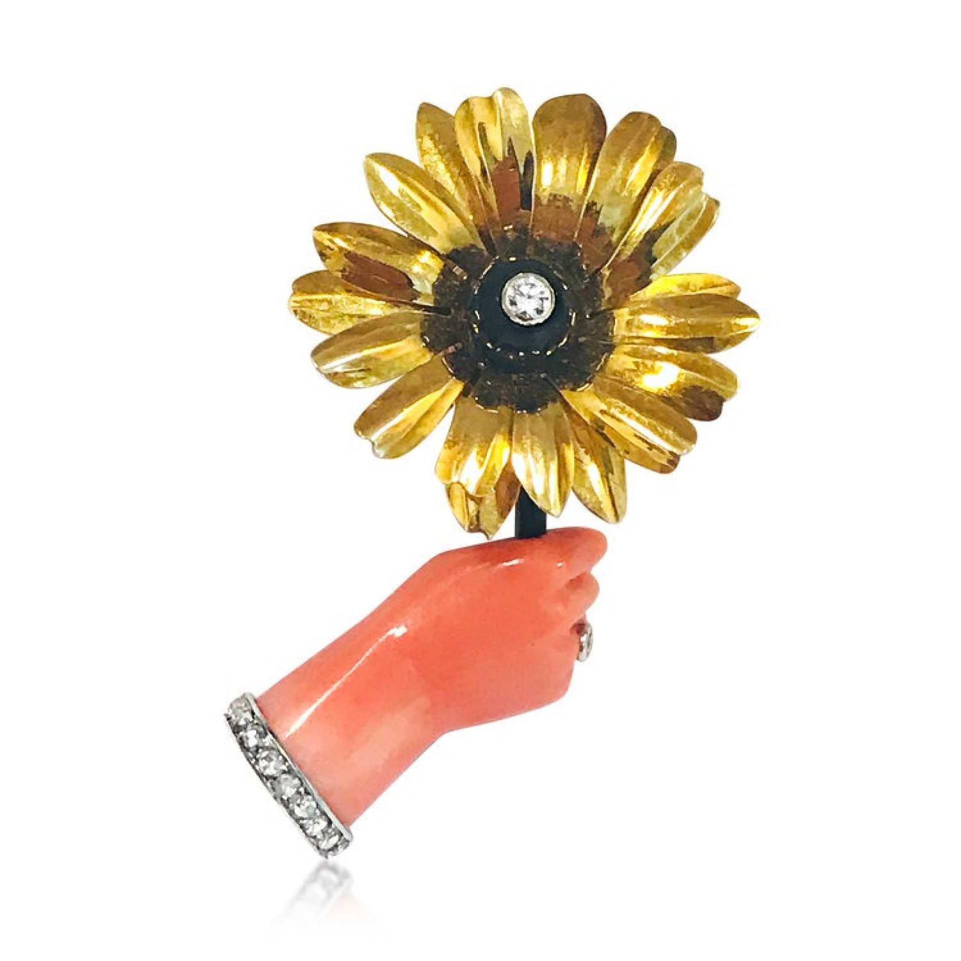 A GOLD AND PLATINUM CORAL DIAMOND HAND WITH FLOWER BROOCH