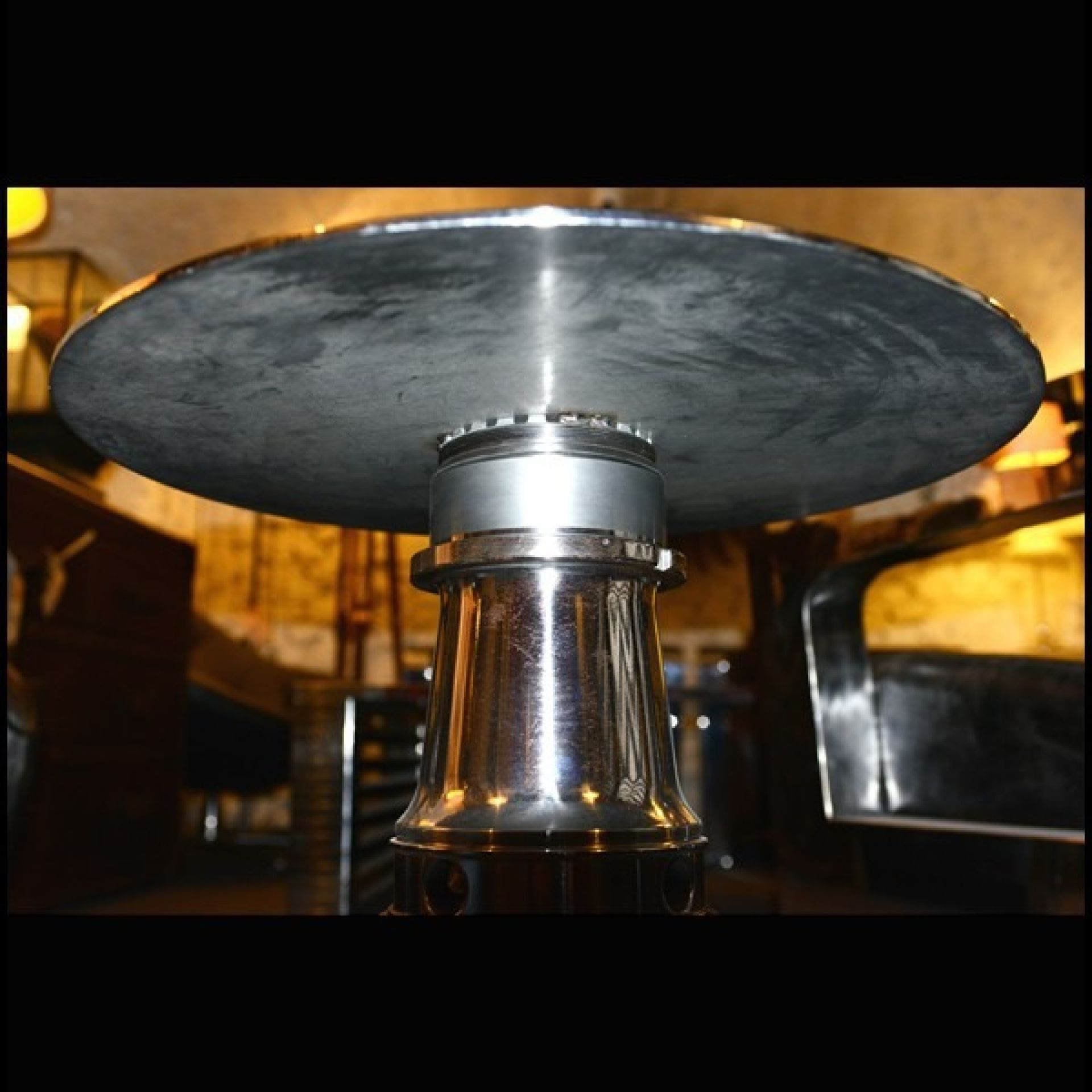 SIDE TABLE MADE FROM A BOEING PC-BOEING 747 AIRCRAFT ENGINE TITANIUM GEAR