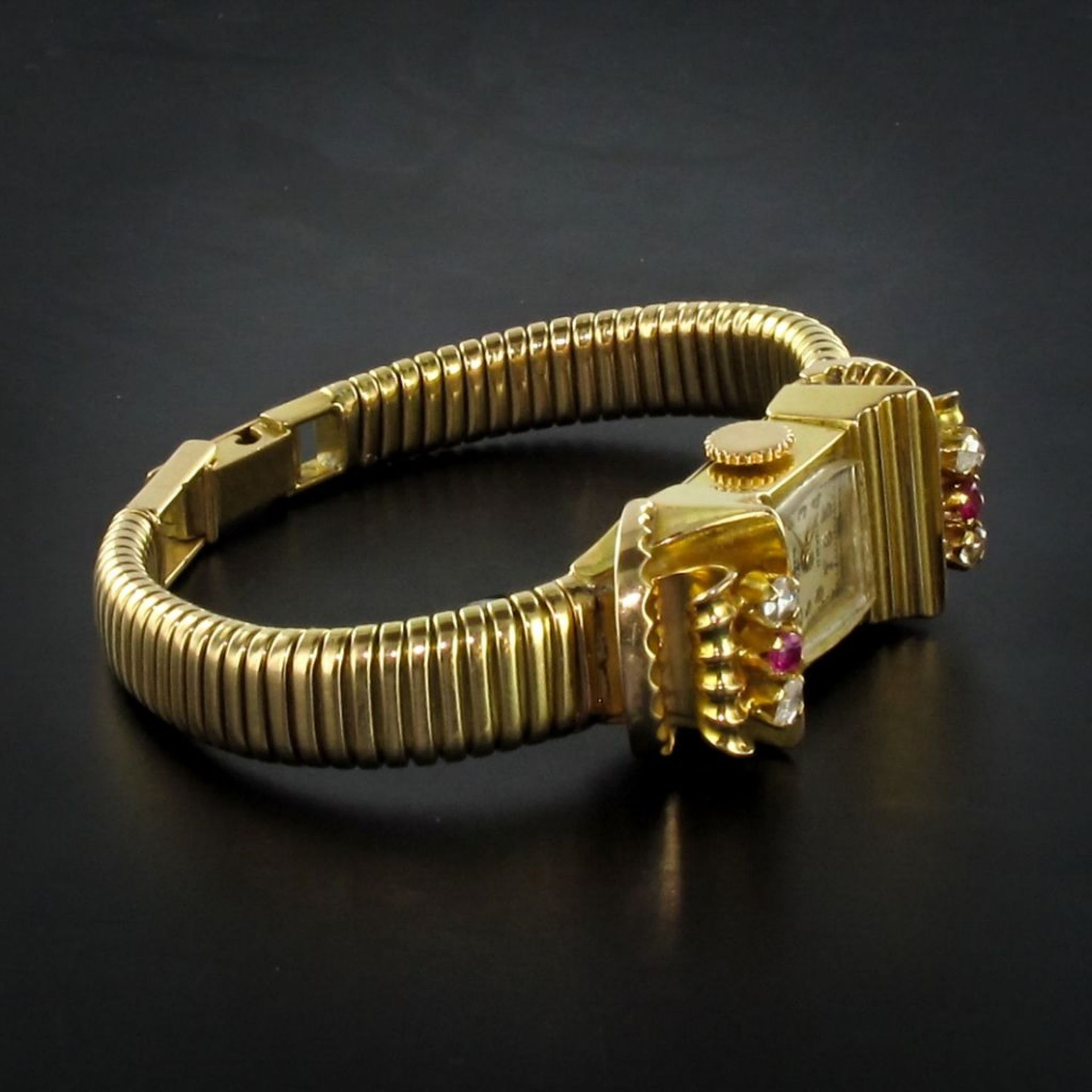 Ruby gold tubogas gold watch