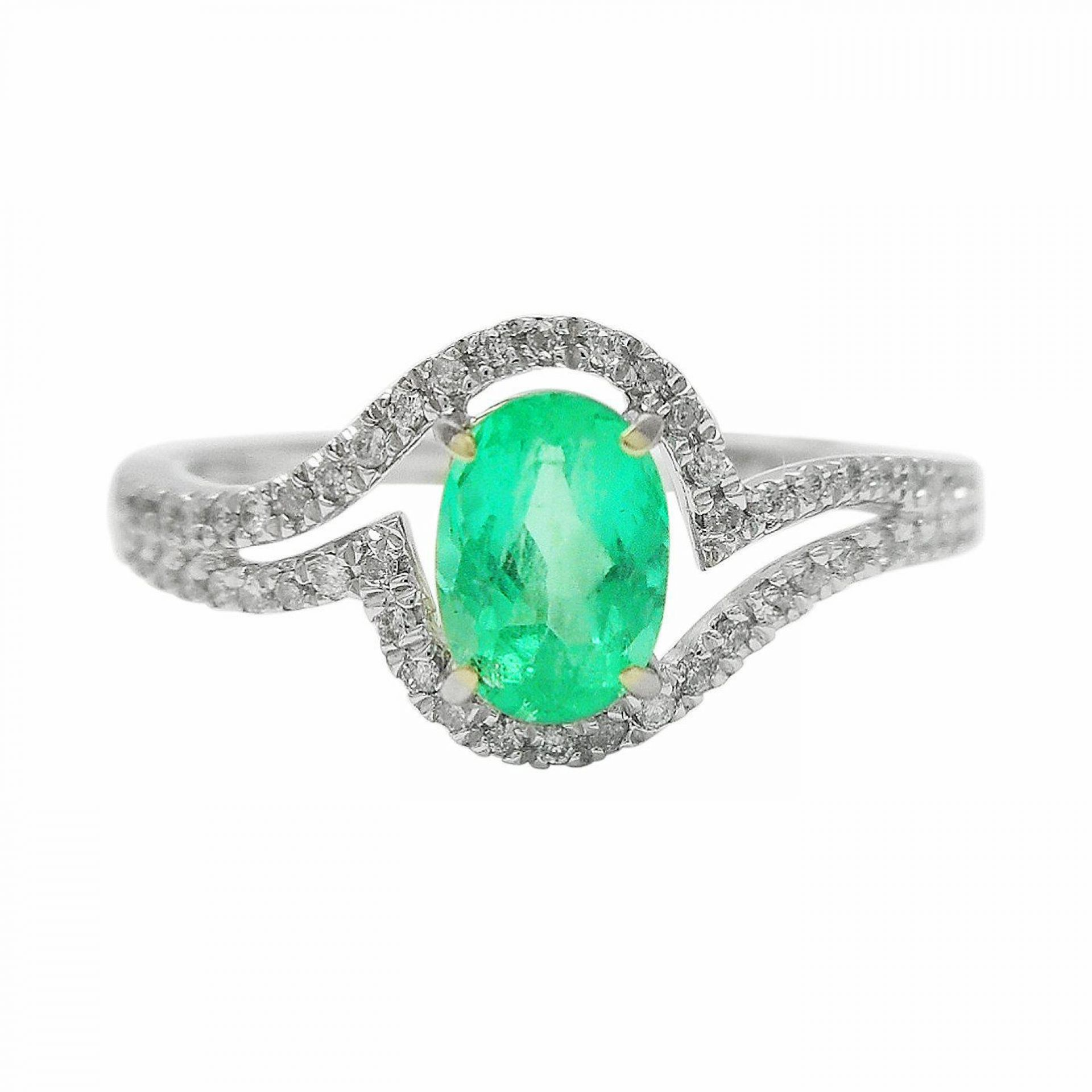 0.56ct Emerald and 0.11ctw Diamond 14KT White Gold Ring