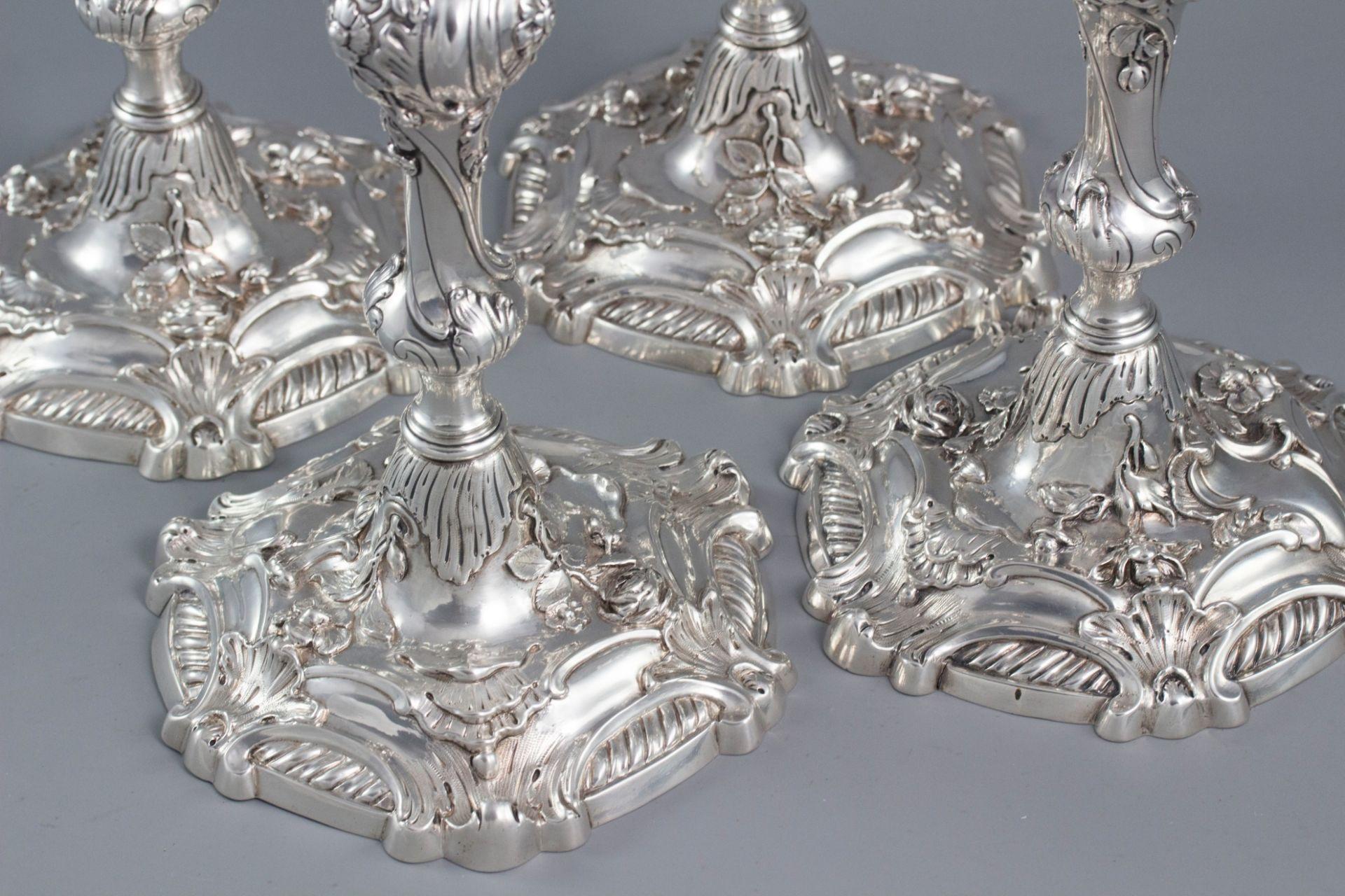 YSL Interest: A set of 4 cast George II Silver Rococo Candlesticks, London 1757