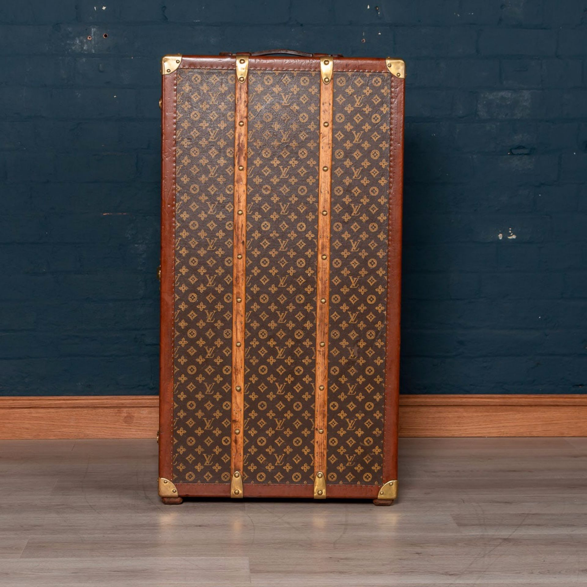 EARLY 20thC LOUIS VUITTON TRUNK WITH CUSTOMISED INTERIOR FOR 60 WATCHES