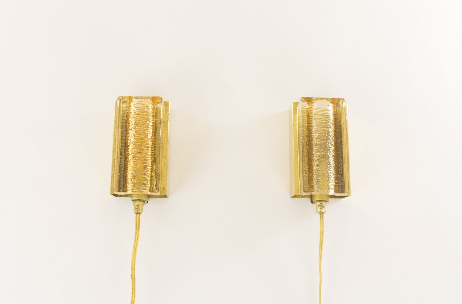 Pair of Atlantic glass and brass Wall lamps by Vitrika in gold, 1970s
