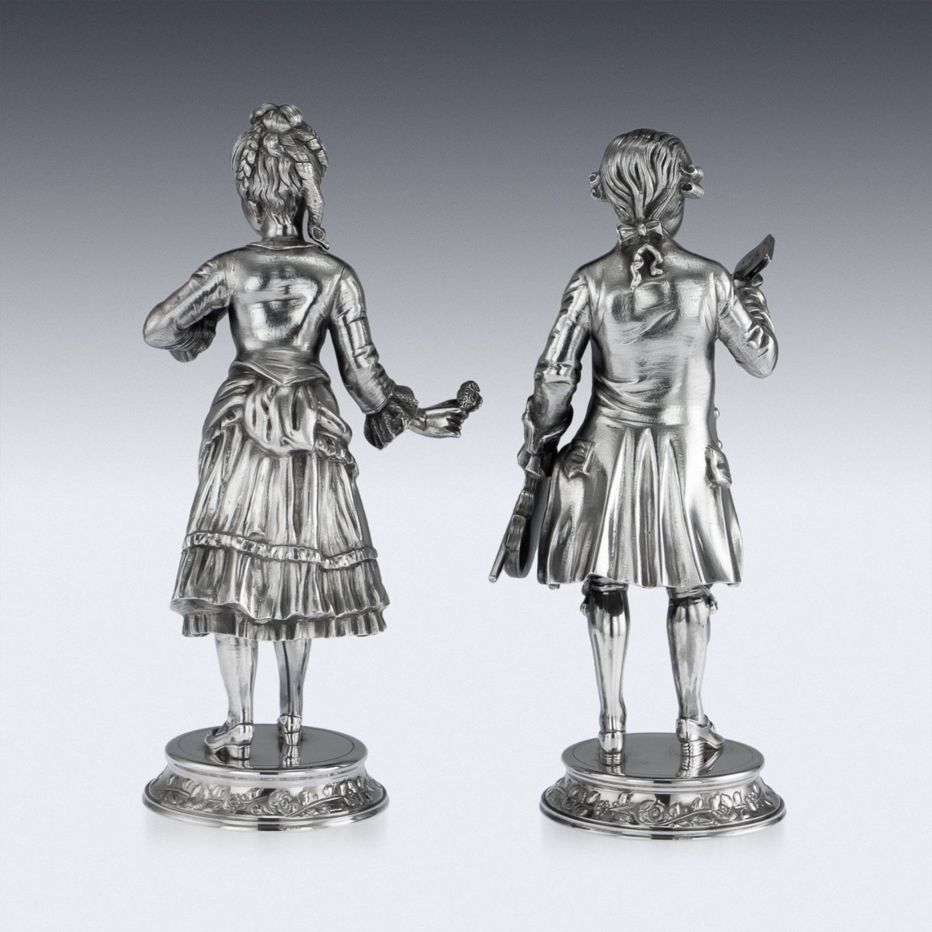 IMPRESSIVE 20THC SOLID SILVER PAIR OF FIGURES, GARRARD & CO C.1986