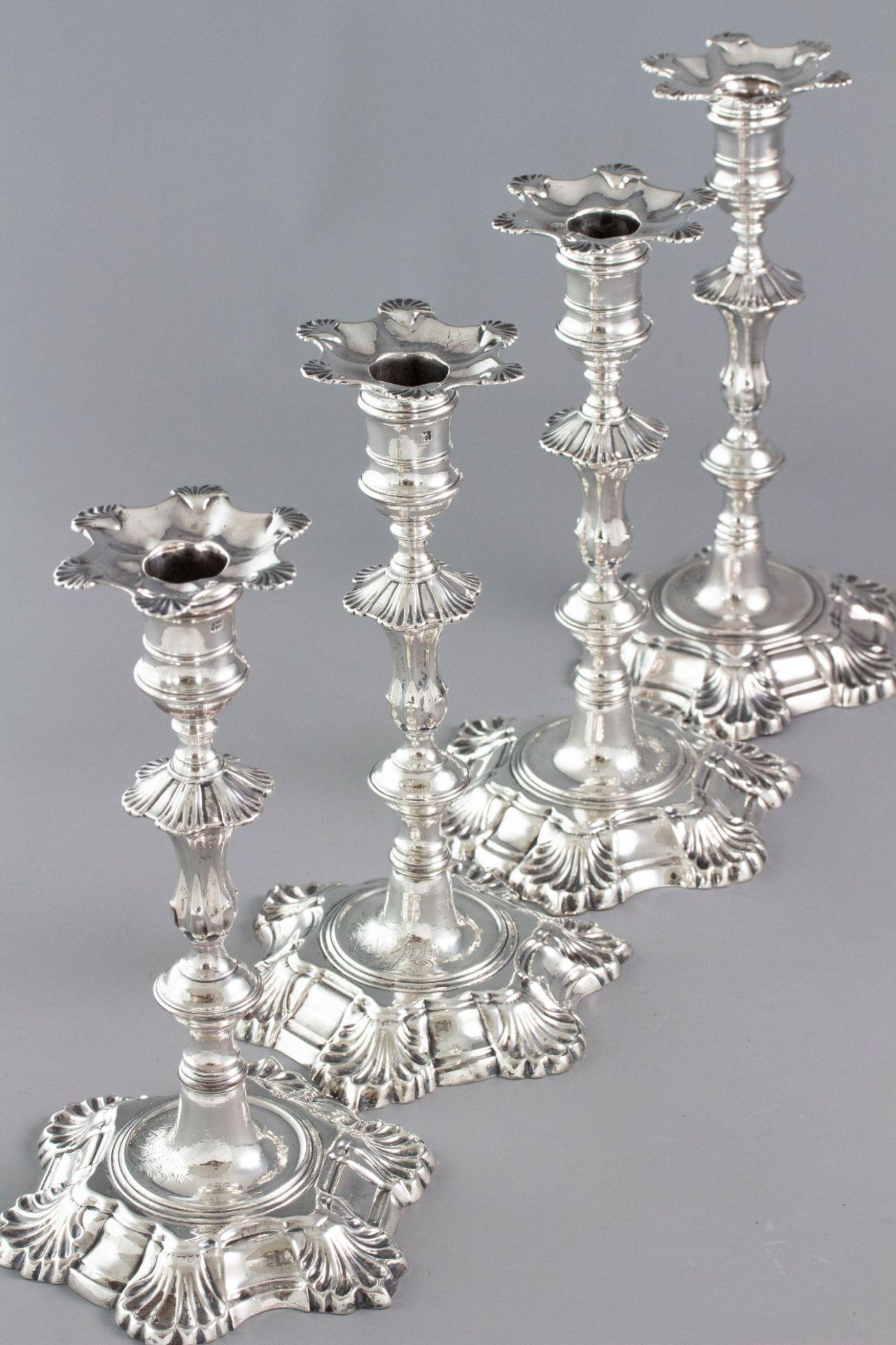 A Very Fine Set of Cast Silver Candlesticks by John Cafe London 1750