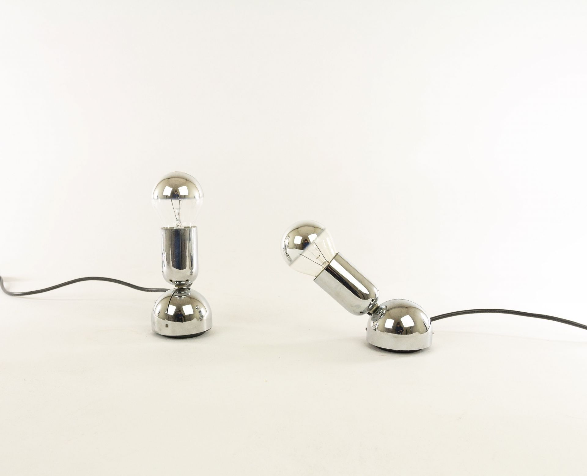 A pair of chrome table or wall lamps model Pollux by Ingo Maurer for Design M, 1