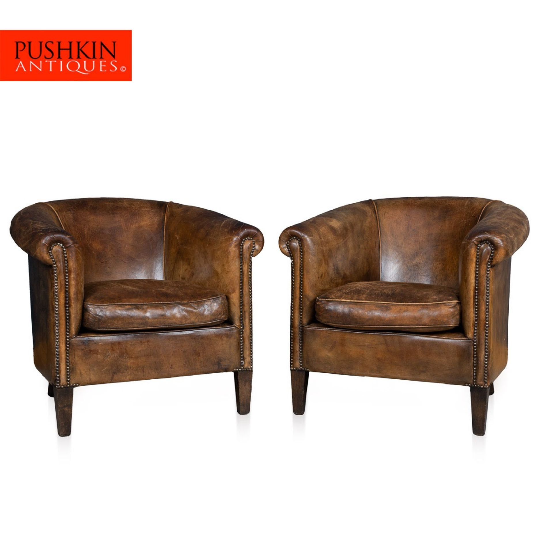STUNNING 20thC PAIR OF DUTCH SHEEPSKIN BROWN LEATHER TUB ARMCHAIRS