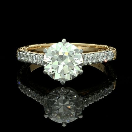 A TRANSITIONAL ROUND BRILLIANT CUT DIAMOND SOLITAIRE RING BY HANCOCKS