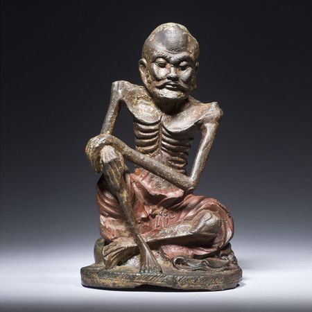 An emaciated Siddhartha figure in lacquered iron