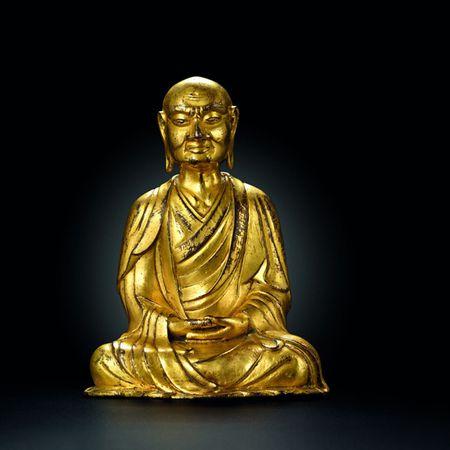 A gilt bronze figure of Luahan Kasyapa