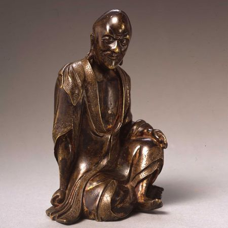 An ungilt seated Luohan
