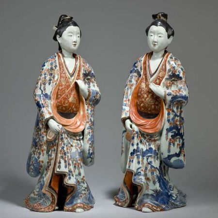 A large pair of Imari porcelain figures of ladies