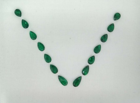 Suite of loose Columbian Emeralds.