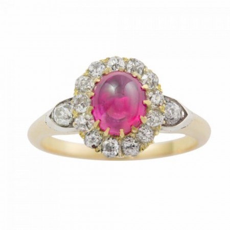 A cabochon ruby and diamond cluster ring