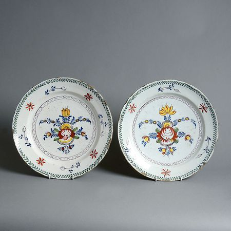 A Pair of Polychrome Faience Chargers