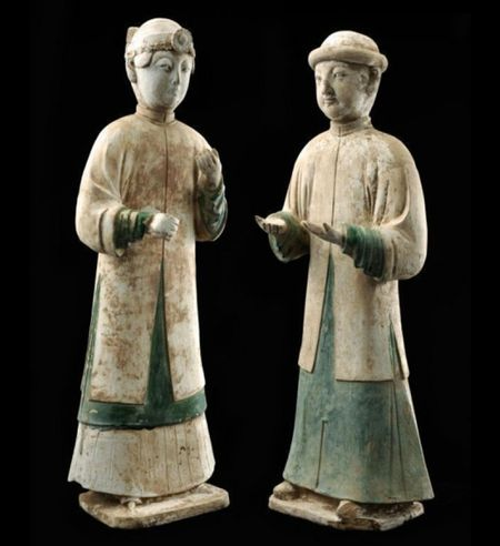 An unusually large set of pottery male and female figures