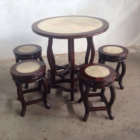 a set of round table and stools